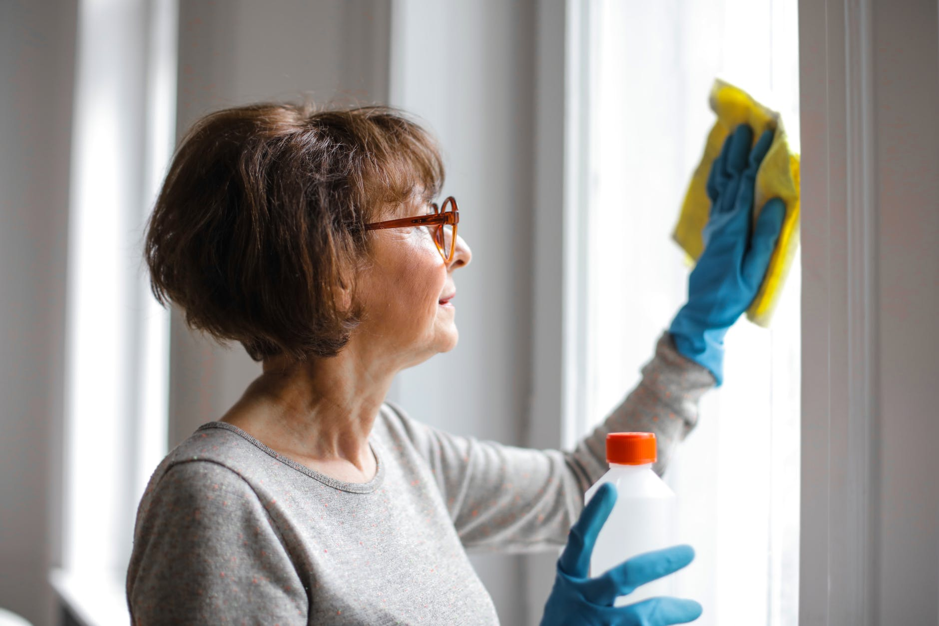 estate agent cleaning her windows