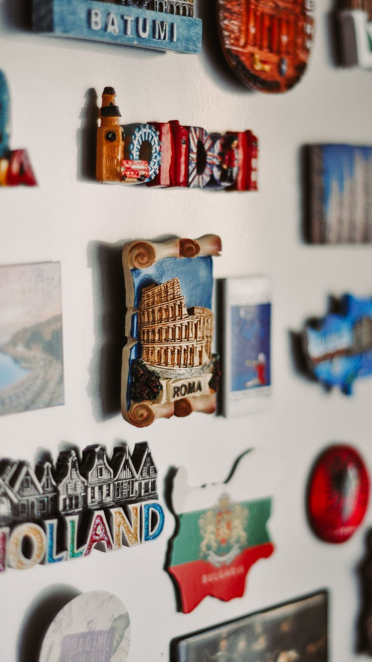 A fridge dorr full of magnets from around the world