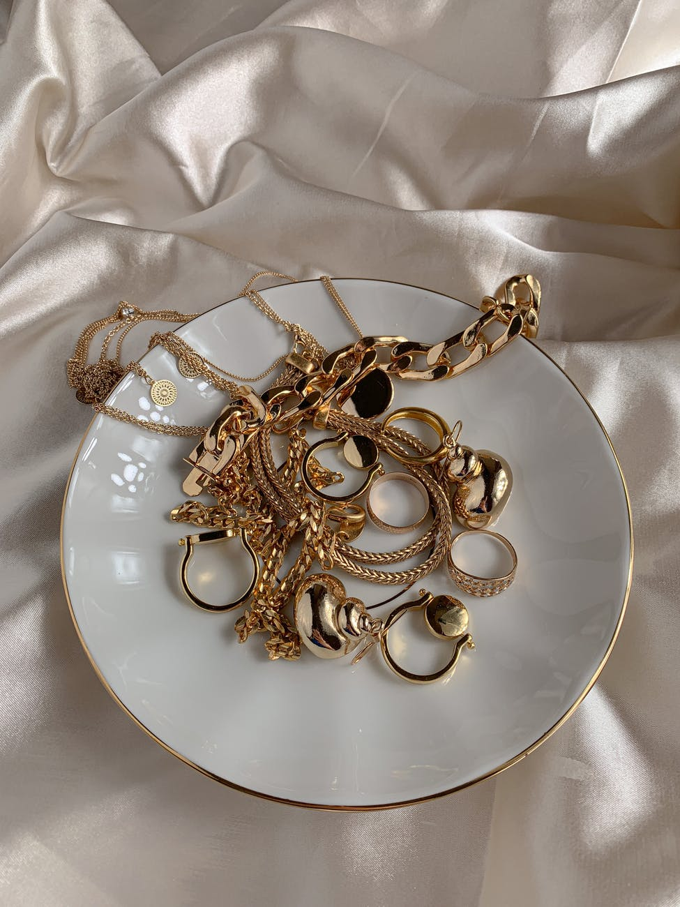 A small dish full of expensive jewellery